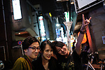 Doris Yeh bassist of Taiwanese Heavy Metal band called Chthonic poses for a picture with fans during an event in a bar in Tokyo on October 13, 2018. Taiwanese band organize a meet and greet event for the release of a new album. October 13, 2018 (Photo by Nicolas Datiche/AFLO) (JAPAN) JAPAN ONLY