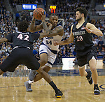 Nevada forward Jordan Caroline (24) drives past San Diego State guard Jeremy Hemsley (42) and guard Jordan Schakel (20) in the second half of an NCAA college basketball game in Reno, Nev., Saturday, Mar. 9, 2019. (AP Photo/Tom R. Smedes)