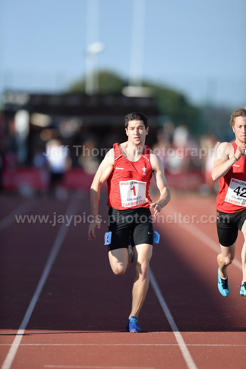 International athletics at Cardiff International stadium, Cardiff, South Wales - Tuesday 15th July 2014<br /> <br /> Drew Hammond of Wales (1) competes in the Men's 100m final 'A' race. <br /> <br /> <br /> Photo by Jeff Thomas Photography