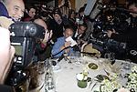 Prix Goncourt 2010 chez Drouant. Michel Houellebecq recoit son cheque de dix euros.