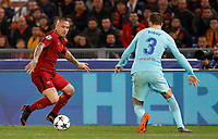 Roma s Radja Nainggolan, left, is challenged by FC Barcelona Gerard Pique during the Uefa Champions League quarter final second leg football match between AS Roma and FC Barcelona at Rome's Olympic stadium, April 10, 2018.<br /> UPDATE IMAGES PRESS/Riccardo De Luca