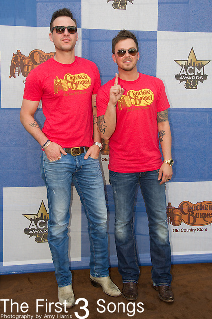 Eric Gunderson and Stephen Barker Liles of Love and Theft attend the Cracker Barrel Old Country Store Country Checkers Challenge at Globe Life Park in Arlington on April 18, 2015 in Arlington, Texas