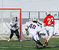 University at Albany Men's Lacrosse defeats Cornell 11-9 on Mar 4 at Casey Stadium.Jordan Dowiak (#23) shoots at JD Colarusso in the Albany goal.