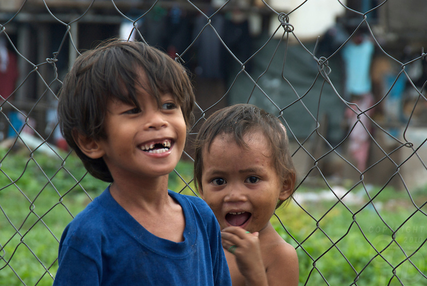 Children in the Slum area of Manila from the Car Window, Philippines