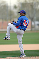 Marcos Mateo #62 of the Chicago Cubs participates in pitchers fielding practice during spring training workouts at the Cubs complex on February 19, 2011  in Mesa, Arizona. .Photo by Bill Mitchell / Four Seam Images.