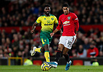 Marcus Rashford (r) of Manchester United runs past Alexander Tettey of Norwich City during the Premier League match at Old Trafford, Manchester. Picture date: 11th January 2020. Picture credit should read: James Wilson/Sportimage