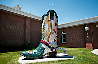 A sculpture of a large cowboy boot stands on display outside the Old West Museum in Cheyenne, Wyoming, Thursday, June 2, 2011.  The museum celebrates Frontier Days which occurs at the end of July...Photo by Matt Nager