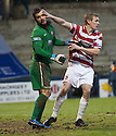 Accies keeper Kevin Cuthbert is congratulated after he saves Raith's Allan Walker's penalty.