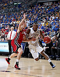 SIOUX FALLS, SD - MARCH 9: Deondre Parks #0 of SDSU drives against defender Brandon Bos #12 of USD in the first half of their semi-final round Summit League Championship Tournament game Monday evening at the Denny Sanford Premier Center in Sioux Falls, SD. (Photo by Dick Carlson/Inertia)
