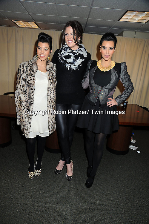 "Kourtney, Khloe and Kim Kardashian at a book signing for ""Kardashian Konfidential""  at Barnes & Noble on 5th Avenue in New York City on.November 30, 2010."