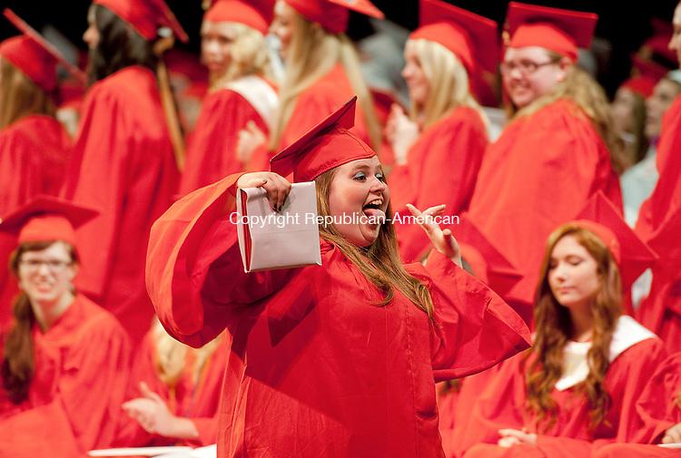 TORRINGTON, CT-061814JS11--Northwestern Regional High School graduate Christine Craighill, celebrates after receiving her diploma during graduation ceremonies Wednesday at the Warner Theatre in Torrington. <br /> Jim Shannon Republican-American