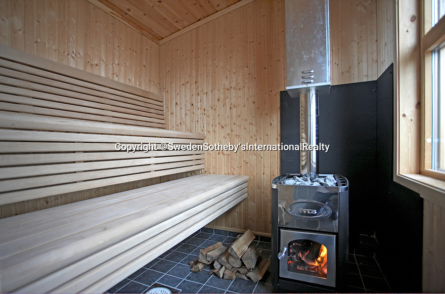 BNPS.co.uk (01202 558833)<br /> Pic: SwedenSotheby's/BNPS<br /> <br /> A sauna on the island will keep you warm.<br /> <br /> A stunning private Swedish island has emerged on to the market for £1.2million ($1.4m) -  the same price as a terraced house in London.<br /> <br /> Gasharsskaret is a 0.27 acre island with flat rock cliffs, sandy beaches and open grassy areas. It is located about 100 yards from the Swedish mainland in the Soderhamn archipelago on the east coast of the country.<br /> <br /> A cluster of cabins have been built on the island, including a main house, a guest house, a beach house and a sauna. It also boasts a wooden hot tub and a landing area for a helicopter.<br /> <br /> The estate agent, Sothebys Realty, say it would be the ideal setting for a large family and could be used for 'retreats and conferences'.