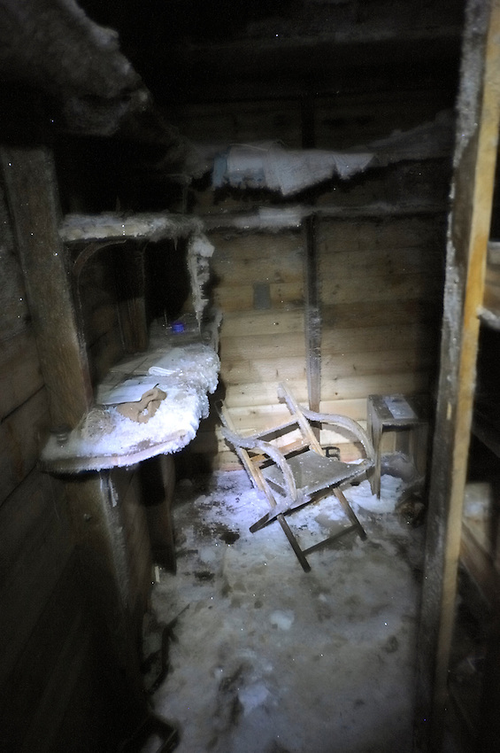 THis is the alcove that Mawson slept and worked in.  The chair was probably broken by ice build up over the years the hut was vacant until conservation started in the 1980's.