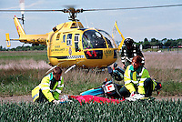 A road traffic accident involving a learner on a motorbike.  The air ambulance was moblized to the rta because the motorcyclist suffered severe head injuries. The helicopter has just landed and the paramedic is running over to help the ambulance crew who are attending the incident. They have stabliized the motorcyclist,  placing him on a spinal board and have put on a total neck brace prior to him being airlifted to hospital...© SHOUT. THIS PICTURE MUST ONLY BE USED TO ILLUSTRATE THE EMERGENCY SERVICES IN A POSITIVE MANNER. CONTACT JOHN CALLAN. Exact date unknown.john@shoutpictures.com.www.shoutpictures.com..
