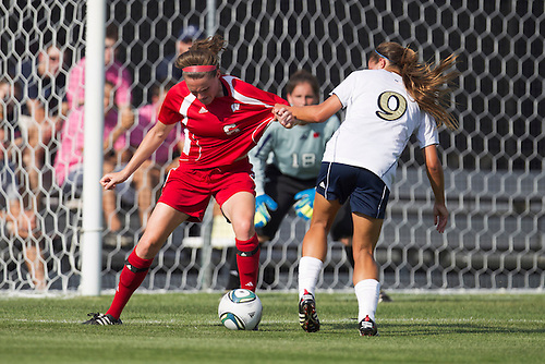 Wisconsin defender Meghan Flannery (#6) and Notre Dame forward Lauren Bohaboy (#9) battle for loose ball in action during NCAA Women's soccer match between Wisconsin and Notre Dame.  The Notre Dame Fighting Irish defeated the Wisconsin Badgers 2-0 in match at Alumni Field in South Bend, Indiana.