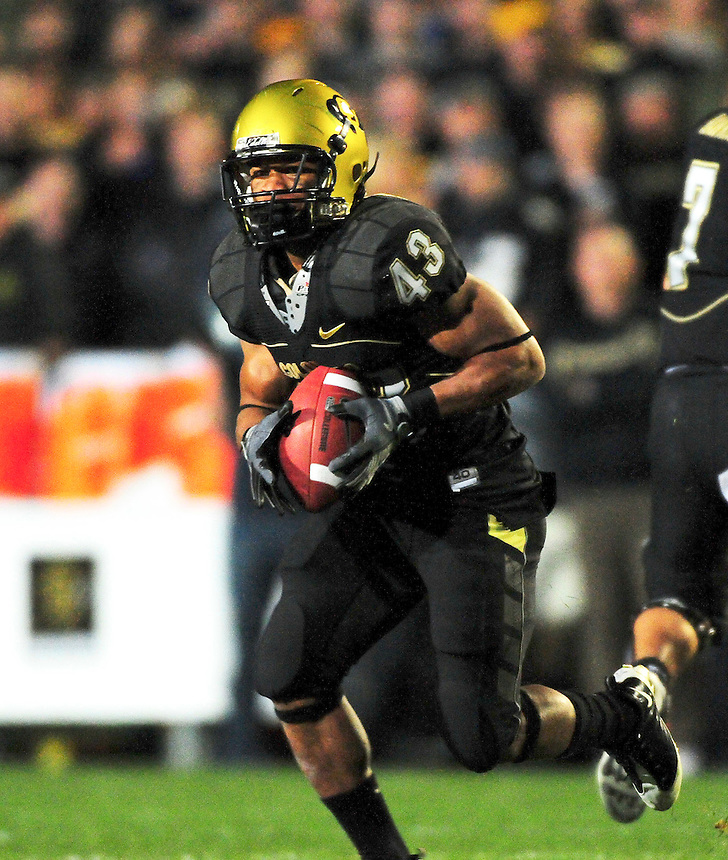 18 September 08: Colorado tailback Rodney Stewart rushes against West Virginia. The Colorado Buffaloes defeated the West Virginia Mountaineers 17-14 in overtime at Folsom Field in Boulder, Colorado. For Editorial Use Only.
