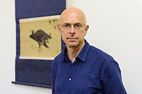 "Timothy Clark, Head of the Japanese Section, standing in front of a scroll painted by Katsushika Hokusai. The British Museum, London, UK, June 21, 2017. ""Hokusai: beyond the Great Wave"" was an exhibition of the works of the ukiyoe woodblock print artist Katsushika Hokusai (1760-1849), held at the British Museum in London from 25 May to 13 August 2017. It focused on works from the last 30 years of the artist's life."