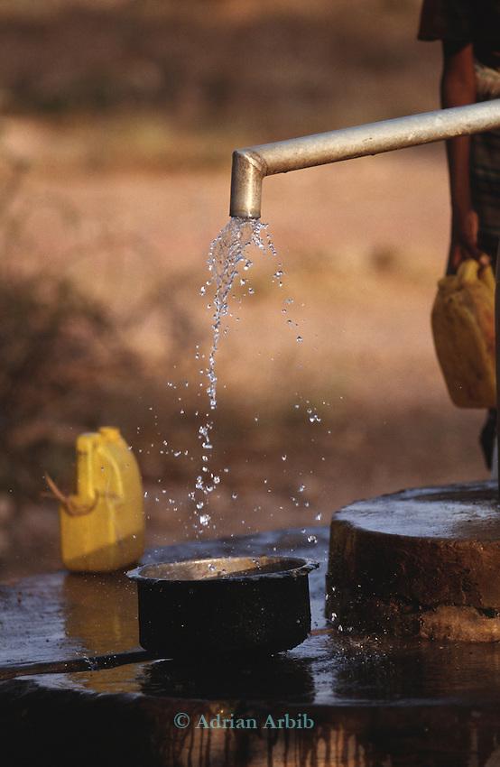 Filling water container from a borehole, Wajir, Somaliland, Kenya