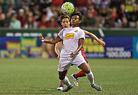 Portland, Oregon - Sunday September 11, 2016: Western New York Flash defender Taylor Smith (11) heads the ball in front of Portland Thorns FC defender Meghan Klingenberg (25) during a regular season National Women's Soccer League (NWSL) match at Providence Park.