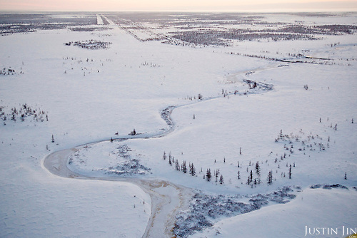 Overview of a frozen river in the tundra in Novy Urengoi, Arctic Siberia, Russia, by Photographer Justin Jin.