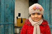 A young Uyghur girl outside of her home in Kashgar. Kashgar is an ancient oasis city with approximately 350,000 residents in the western part of China's Xinjiang Uyghur Autonomous Region at the far edge of the Taklamakan Desert..