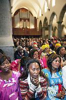 Switzerland. Canton Valais. St-Maurice. Africa Saints Pilgrimage (P&egrave;lerinage aux Saints d'Afrique). Religious <br /> ceremony in St-Maurice's abbey. African women and men gather for a catholic mass. 2.06.13 &copy; 2013 Didier Ruef