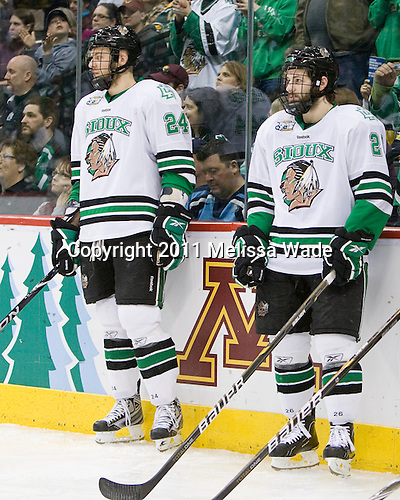 Ben Blood (North Dakota - 24), Brett Hextall (North Dakota - 26) - The University of Michigan Wolverines defeated the University of North Dakota Fighting Sioux 2-0 in their 2011 Frozen Four Semi-Final on Thursday, April 7, 2011, at the Xcel Energy Center in St. Paul, Minnesota.