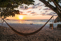 Sunset on beach with hammock at Punta Mita, Mexico.