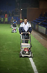 The groundsmen mowing the pitch shortly after the final whistle at Prenton Park as Tranmere Rovers lose to Stoke City in a Capital One Cup third round match. The Capital One cup was formerly known as the League Cup and was competed for by all 92 English Premier League and Football League clubs. Visitors Stoke City won the match 2-0, watched by a crowd of 5,559 spectators.