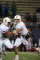 Oct 30, 20010:  Stanford quarterback #12 Andrew Luck fakes the handoff and rolls out to hie right against Washington.  Stanford defeated Washington 41-0 at Husky Stadium in Seattle, Washington.