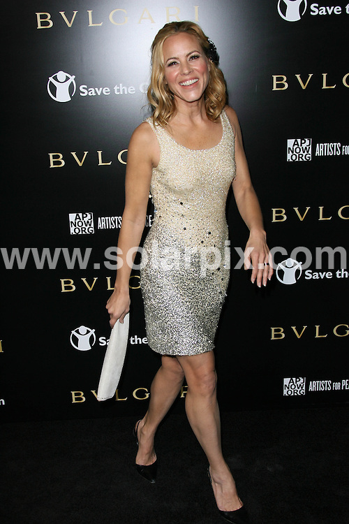 **ALL ROUND PICTURES FROM SOLARPIX.COM**                                             **SYNDICATION RIGHTS FOR UK, AUSTRALIA, DENMARK, PORTUGAL, S. AFRICA, SPAIN & DUBAI (U.A.E) & ASIA (EXCLUDING JAPAN) ONLY**                                                                                  Caption:  Arrivals at the Bvlgari Private Event honouring Simon Fuller and Paul Haggis to Benefit Save the Children and Artists for Peace and Justice, held at the Ron Burkle Residence, Beverly Hills, USA. 13 January 2011                                                                    This pic: Maria Bello                                                   JOB REF: 12666 PHZ Charlotte      DATE: 13_01_2011                                                           **MUST CREDIT SOLARPIX.COM OR DOUBLE FEE WILL BE CHARGED**                                                                      **MUST AGREE FEE BEFORE ONLINE USAGE**                               **CALL US ON: +34 952 811 768 or LOW RATE FROM UK 0844 617 7637**