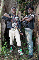 TwoAnti-Balaka (Anti-Machete) fighters, one holding a homemade rifle. In late 2012 after years of instability and conflict, the Seleka, a predominantly Muslim rebel group, fuelled by grievances against the government, overran the country and, In March 2013, ousted President Francois Bozize, who fled the country. The rebel's leader Michel Djotodia was proclaimed president in August 2013. He disbanded the Seleka in September 2013 but law and order collapsed and ex-Seleka fighters roamed the country committing atrocities against the civilian population. In an attempt to defend their lives and property vigilante groups, calling themselves Anti-Balaka (Anti-Machete), formed to confront the ex-Seleka fighters but soon began to take reprisals against the wider Muslim population and the conflict became increasingly sectarian. By December 2013, with international fears of a genocide being voiced, French led peacekeepers deployed to the country began to act on a UN mandate to disarm the fighters and protect the civilian population. However, they have struggled to contain the situation. Much of the Muslim population, in particular, have been forced into ghettos where they are suffering from food shortages and limited access to healthcare. Often, only a few peacekeepers stand between them and a massacre by vengeful Anti-Balaka militants. UN reports describe 'thousands' killed, while over 600,000 people have been internally displaced and a further 200,000 have fled the county.