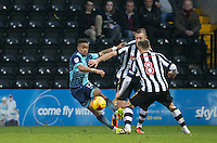 Paris Cowan-Hall of Wycombe Wanderers holds off players during the Sky Bet League 2 match between Notts County and Wycombe Wanderers at Meadow Lane, Nottingham, England on 10 December 2016. Photo by Andy Rowland.
