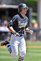 Vanderbilt Commodores center fielder Bryan Reynolds (20) runs to first during a game agains against the Tennessee Volunteers at Lindsey Nelson Stadium on April 24, 2016 in Knoxville, Tennessee. The Volunteers defeated the Commodores 5-3. (Tony Farlow/Four Seam Images)