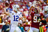 Landover, MD - September 16, 2018: Indianapolis Colts quarterback Andrew Luck (12) is pressured in the pocket by Washington Redskins linebacker Ryan Kerrigan (91) during game between the Indianapolis Colts and the Washington Redskins at FedEx Field in Landover, MD. The Colts defeated the Redskins 21-9.(Photo by Phillip Peters/Media Images International)