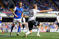 George Byers of Swansea City (R) protests to referee Darren England during the Sky Bet Championship match between Ipswich Town an Swansea City at Portman Road Stadium, Ipswich, England, UK. Monday 22 April 2019