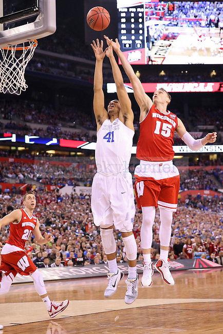 Forward Trey Lyles of the Kentucky Wildcats fights for a rebound with Forward Sam Dekker of the Wisconsin Badgers during the game against the Wisconsin Badgers in the Final Four of the 2015 NCAA Men's Basketball Tournament at Lucas Oil Stadium on Saturday, April 4, 2015 in Indianapolis, In.  Photo by Jonathan Krueger | Staff.