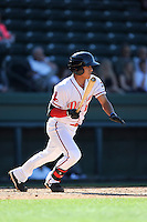 Shortstop Tzu-Wei Lin (36) of the Greenville Drive bats in a game against the Asheville Tourists on Wednesday, April 23, 2014, at Fluor Field at the West End in Greenville, South Carolina. Lin is the No. 28 prospect of the Boston Red Sox, according to Baseball America. Greenville won, 6-0. (Tom Priddy/Four Seam Images)