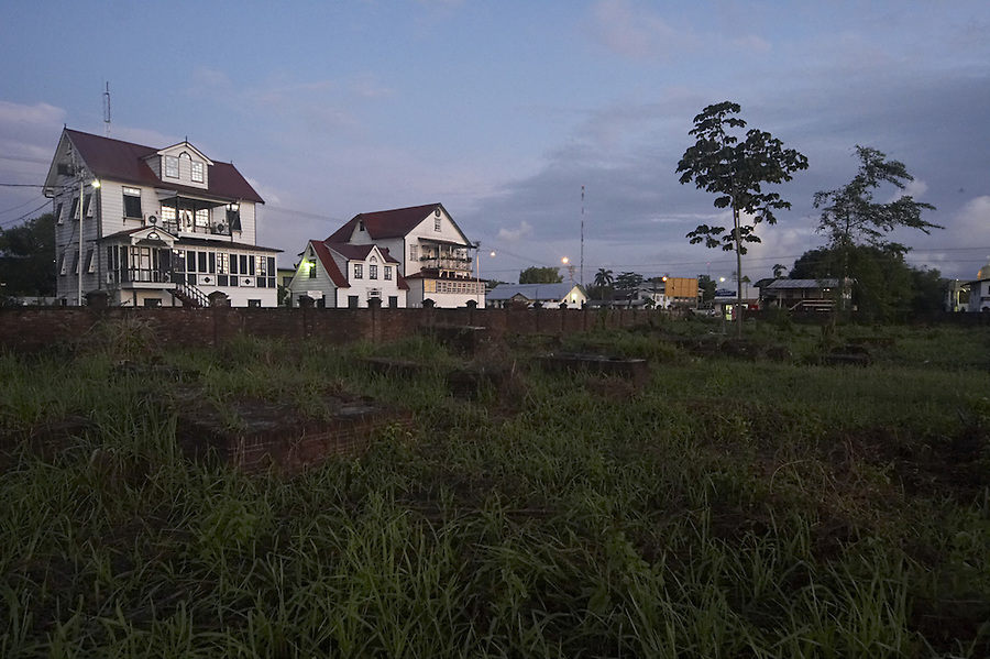 View of old colonial houses from an abandoned cemetery in Paramaribo, Suriname.
