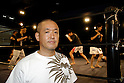 "May 17, 2008, Tokyo, Japan - Yukinori Kitajima, co-founder of Doglegs. Wrestlers warm up in the background. Able-bodied Kitajima wrestles under the name ""Antithesis Kitajima"".  (Photo by Tony McNicol/AFLO)"