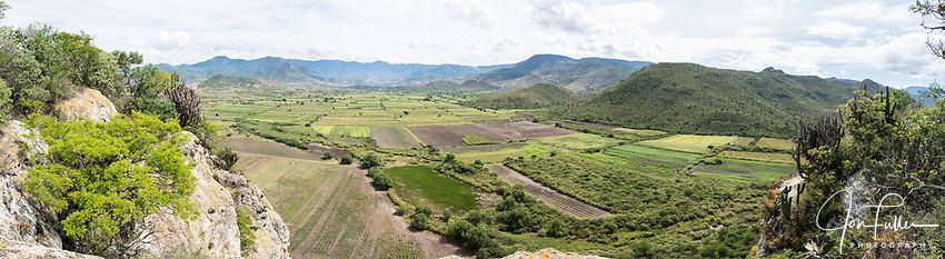 A view of the Tlacolula Valley from the fortress hill at Yagul, Oaxaca, Mexico.  Agave fields for the production of mescal can be seen at center.