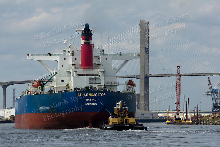 Savannah Bridge over the Savannah River and a Container ship and tug boat
