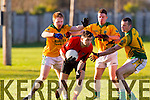 Fintan Coffey Fossa in action against Enda Whelan Nick Fitzgerald and Micheal O'Shea Castlegregory in the relegation playoff in the Kerry county football league.
