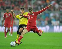 FUSSBALL   1. BUNDESLIGA  SAISON 2011/2012   13. Spieltag  19.11.2011 FC Bayern Muenchen - Borussia Dortmund         Thomas Mueller (re, FC Bayern Muenchen) gegen Sebastian Kehl (Borussia Dortmund)