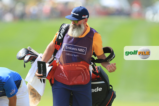 Nick Pugh caddy for Lucas Herbert (AUS) on the 1st fairway during Round 4 of the Omega Dubai Desert Classic, Emirates Golf Club, Dubai,  United Arab Emirates. 27/01/2019<br /> Picture: Golffile | Thos Caffrey<br /> <br /> <br /> All photo usage must carry mandatory copyright credit (© Golffile | Thos Caffrey)
