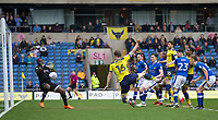 Goalkeeper Johnny Placide of Oldham Athletic saves a shot at goal by Rob Dickie of Oxford United during the Sky Bet League 1 match between Oxford United and Oldham Athletic at the Kassam Stadium, Oxford, England on 7 April 2018. Photo by Andy Rowland.