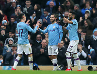 26th January 2020; Etihad Stadium, Manchester, Lancashire, England; English FA Cup Football, Manchester City versus Fulham; Bernardo Silva of Manchester City celebrates his opening goal from the penalty spot with teammates Phil Foden and Riyad Mahrez