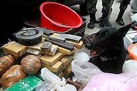 RIO DE JANEIRO, 13 JULHO 2012 - OPERACAO COMUNIDADE MANDELA - Na  manhã dessa  sexta-feira(13),  policias  do batalhão  de  choque com apoio da campanhia de  cães, fizeram operação na  comunidade de  manguinhos de mandela na  zona  norte do  RJ. Cães  da policia , encontraram munições de  diversos  calibres, maconha, cocaína e material  para  endolação no interior  da  comunidade do mandela. As apreenções  foram  levadas  para  21ªDP. FOTO: GUTO MAIA - BRAZIL PHOTO PRESS.