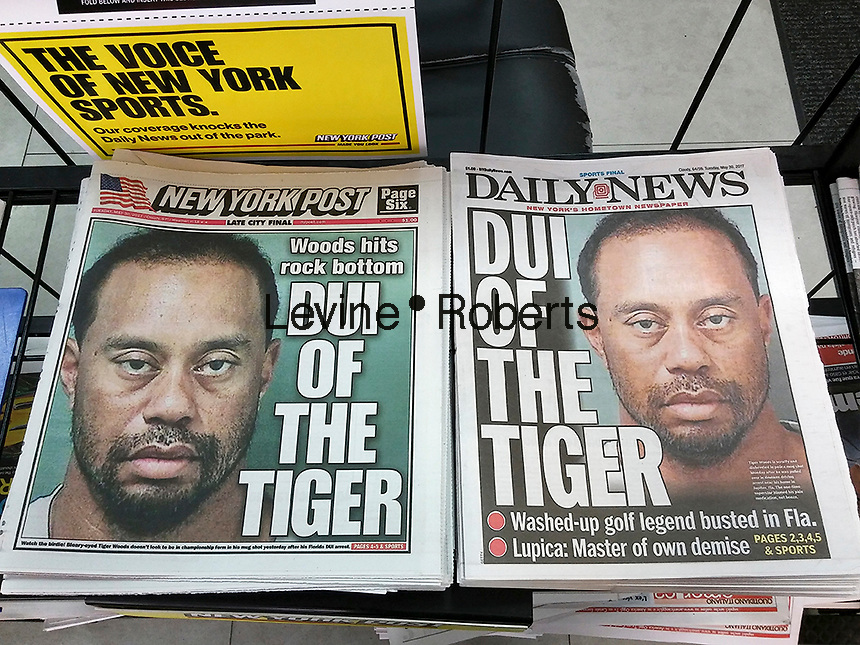 The New York Daily News and the New York Post on Tuesday, May 30, 2017 use identical headlines and the Palm Beach County Sheriff Department's official mugshot in their coverage of golfer Tiger Woods' arrest allegedly for DUI..  (© Richard B. Levine)