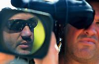 Oct 4, 2008; Talladega, AL, USA; NASCAR Sprint Cup Series driver Tony Stewart reflects in the lens of a video camera as he is interviewed during qualifying for the Amp Energy 500 at the Talladega Superspeedway. Mandatory Credit: Mark J. Rebilas-